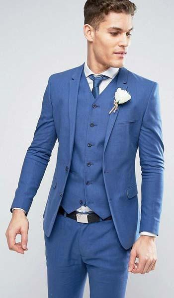 ผ้าเรียบหรูชุดสูทสีฟ้าเเมตท์กับเน็คไทด์สีฟ้าเเละดอกไม้สีขาว